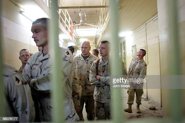 A group of American soldiers takes a tour of the Iraqigovernmentrun section of the Abu Ghraib Prison October 28 2005 on the outskirts of Baghdad Iraq...