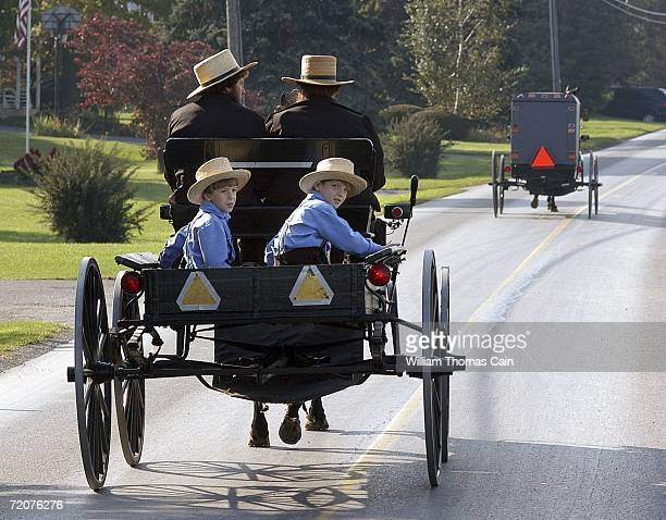 A group of Amish children ride in a buggy near the one room Amish school house where five girls were murdered October 3 2006 in Nickel Mines...