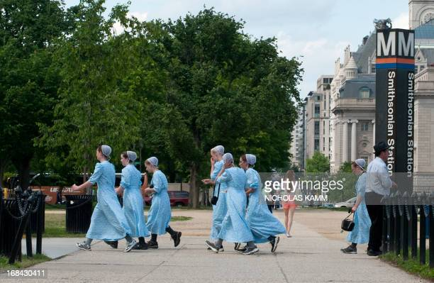 A group of Amish girls walk on the Mall while sightseeing in Washington on May 9 as they celebrate the day of Ascension AFP PHOTO/Nicholas KAMM
