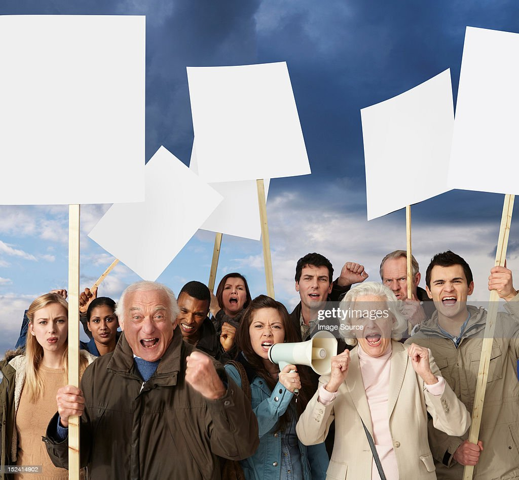 Group of angry protesters holding blank banners : Stock Photo