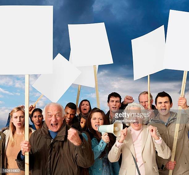 group of angry protesters holding blank banners - protestor stock pictures, royalty-free photos & images