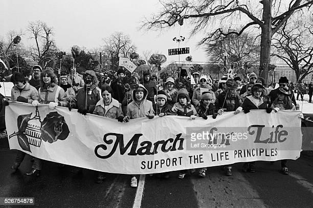 A group of anti abortionists hold a 'March for Life' banner during a rally on the Supreme Court anniversary of Roe vs Wade in Washington DC