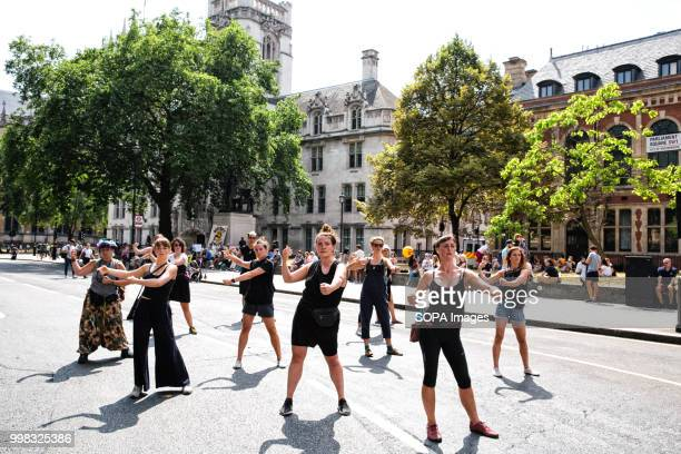 A group of antiTrump protesters seen performing an interpretative dance Protest by antiTrump supporters against Donald Trumps visit to the United...