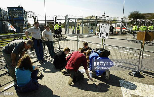 Group of anti-war protesters sit outside of RAF Fairford April 5, 2003 in Fairford, England. A much smaller than anticipated number of protesters...