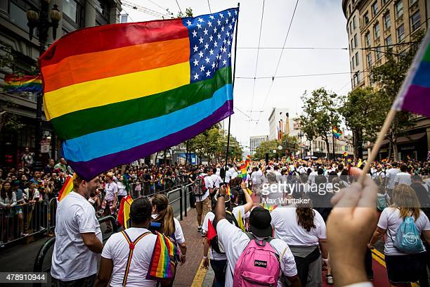 A group of Apple employees march in the San Francisco Gay Pride Parade June 28 2015 in San Francisco California The 2015 pride parade comes two days...