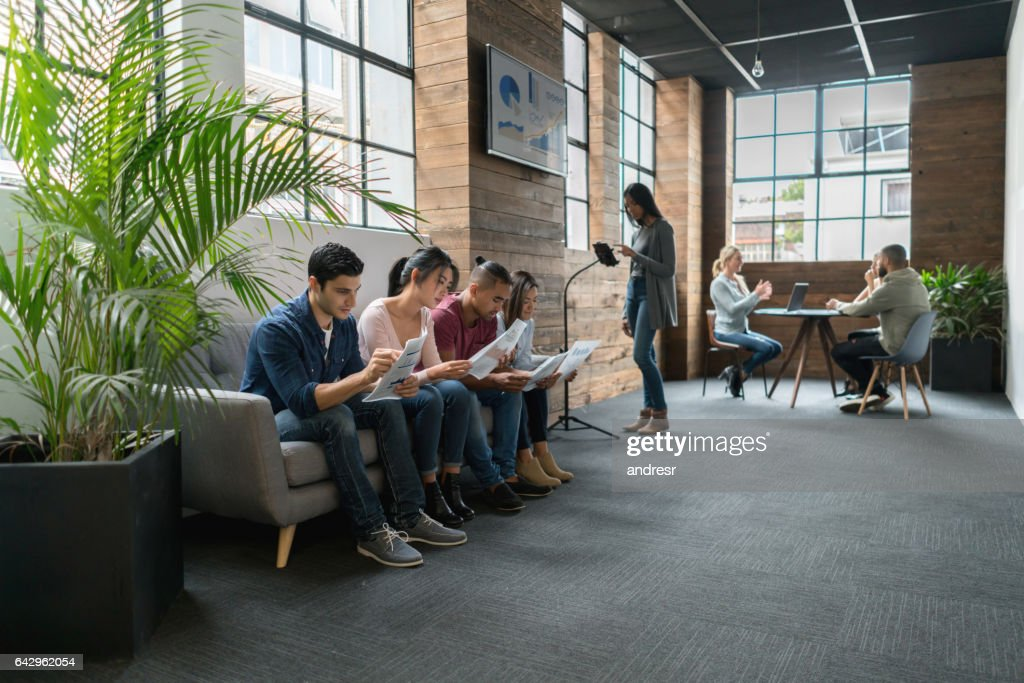 Group of applicants waiting for their turn for an interview : Stock Photo