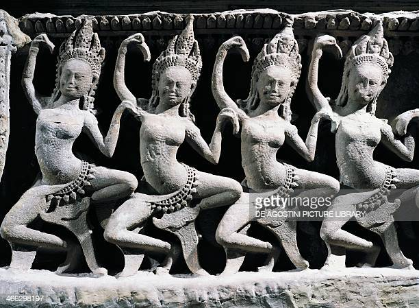 Group of apsara female spirits of the clouds and water basrelief in Bayon Temple Angkor Archaeological Complex Angkor Cambodia Khmer art 12th century