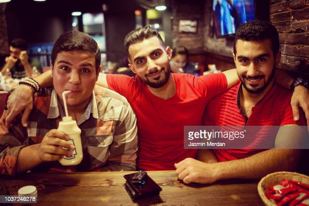 group of arab boys together - jordan middle east stock pictures, royalty-free photos & images