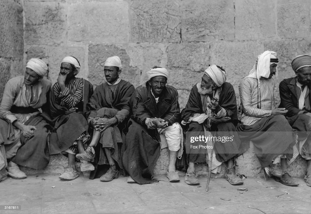 a group of arab men natives of jerusalem at the jaffa gate in the