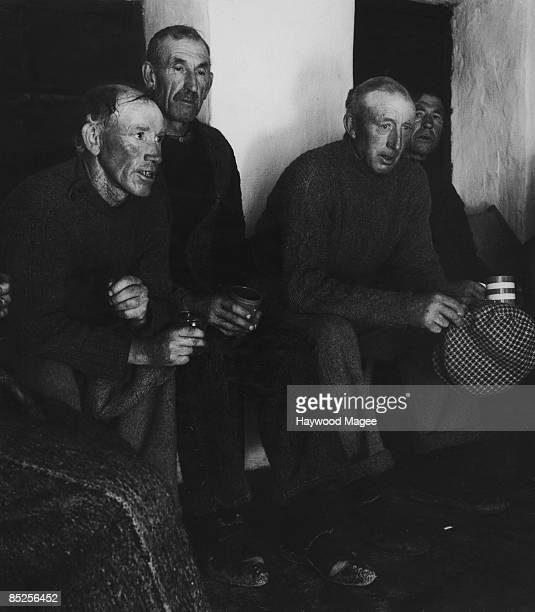 A group of Aran Islanders hold a singalong to welcome the return of American filmmaker Robert J Flaherty September 1949 Flaherty made the documentary...