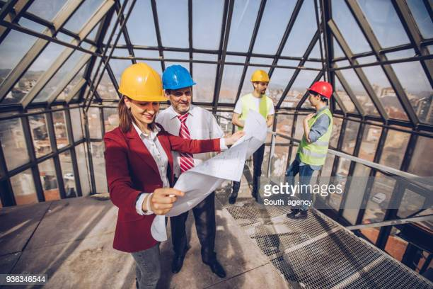 Group of architects checking the progress