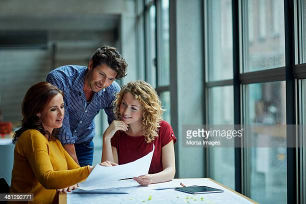 group of architects discussing projects - three people stock pictures, royalty-free photos & images