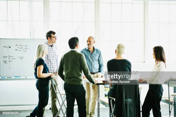 group of architects having project meeting in design studio conference room - honesty stock pictures, royalty-free photos & images