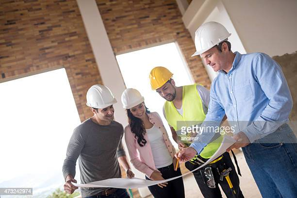 Group of architects looking at blueprints
