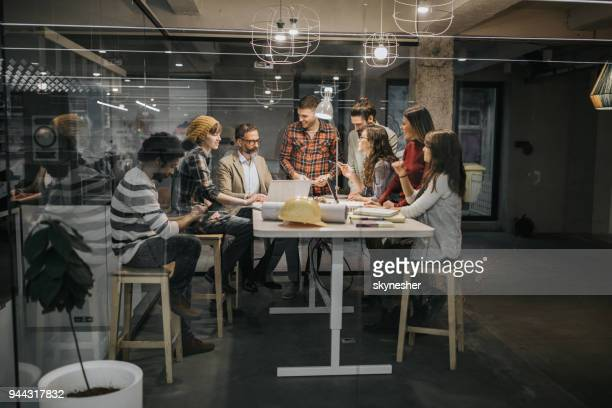 Group of architects talking while having a meeting at casual office.