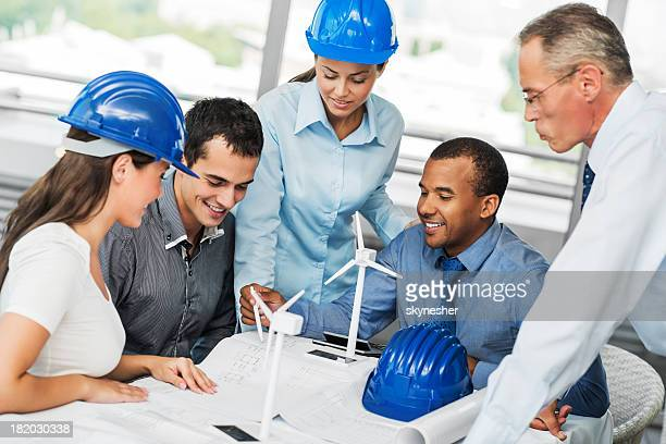 Group of architects working on a Wind Turbine project