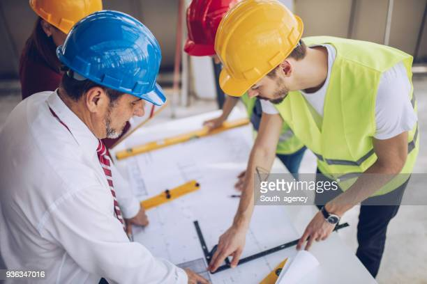Group of architects working on construction site