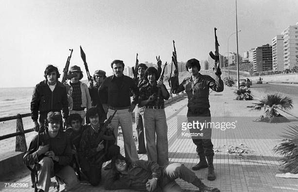A group of armed men on the sea front in Beirut during the Civil War in Lebanon December 1975
