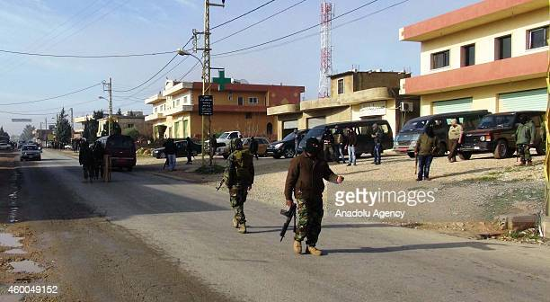 A group of armed men stop and inspects vehicles came from Arsal town near Syria border on the streeet of Bazzaliyeh village in Beqaa Lebanon on...