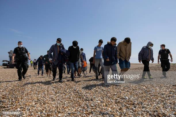 Group of around 40 migrants arrive via the RNLI on Dungeness beach on August 04, 2021 in Dungeness, England. UK Home Secretary Priti Patel recently...