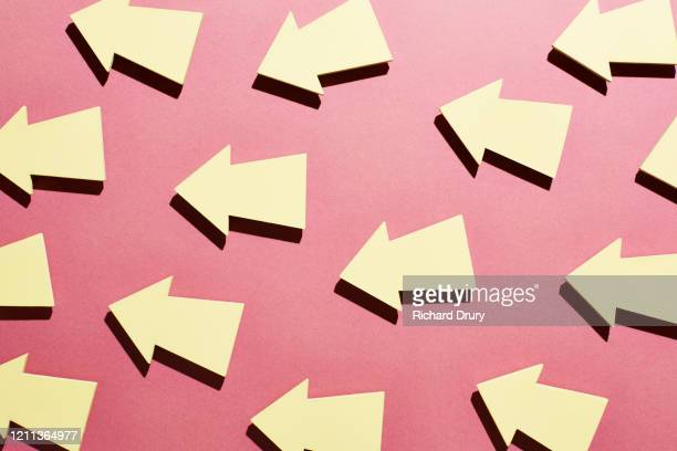 a group of arrows all moving forward together - richard drury stock pictures, royalty-free photos & images