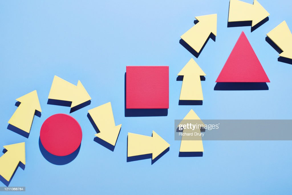 A group of arrows moving around obstacles in their path : Stock Photo