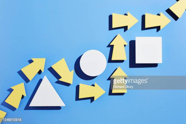 a group of arrows moving around obstacles in their path - richard drury stock pictures, royalty-free photos & images
