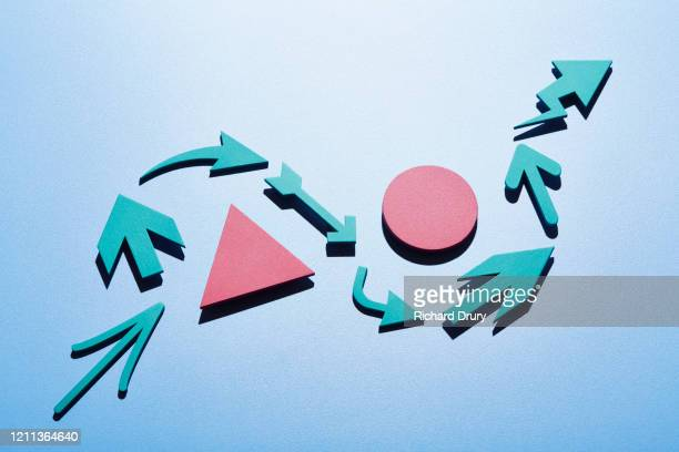 a group of arrows moving up and around obstacles - planning stock pictures, royalty-free photos & images