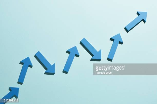 a group of arrows moving up together - in a row stock pictures, royalty-free photos & images