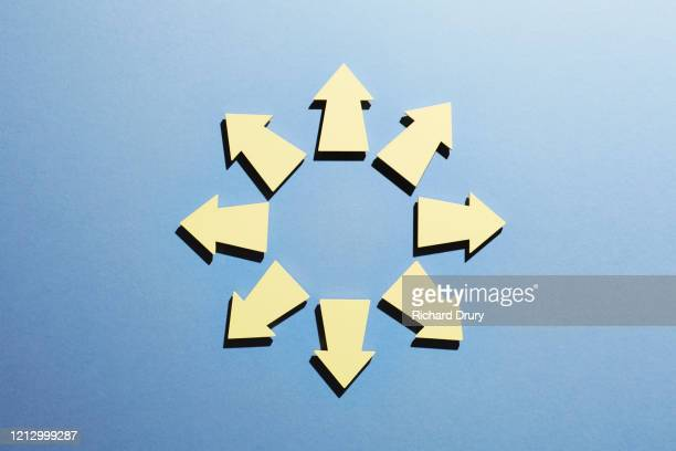 a group of arrows pointing in all directions - continuous stock pictures, royalty-free photos & images
