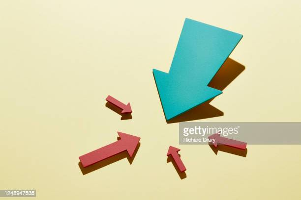 a group of arrows pointing to the same spot - advice stock pictures, royalty-free photos & images