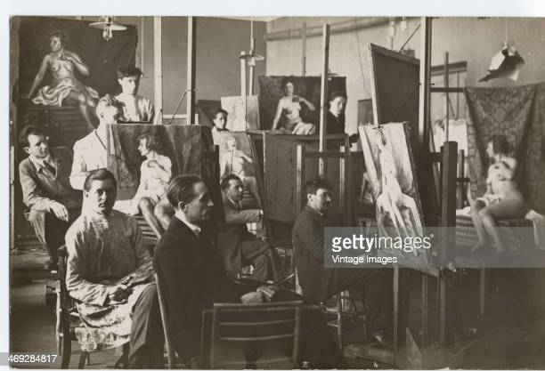A group of artists and a nude model in a life painting class circa 1920