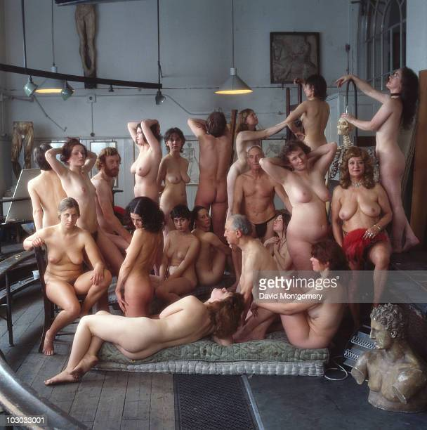 Group of artists' models pose nude in a studio, circa 1990.