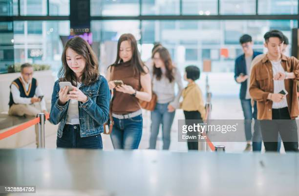 group of asian chinese audience in front ticket counter waiting in line buying movie tickets before movie show time at movie theater cinema - medium group of people stock pictures, royalty-free photos & images
