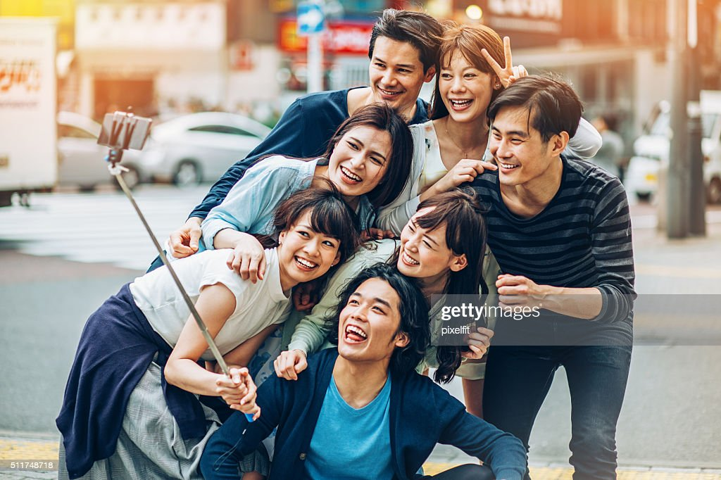 Group of Asian ethnicity friends making selfie : Stock Photo