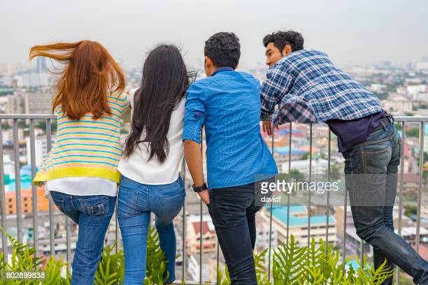 Group of Asian Friends Looking at the View from the Roof
