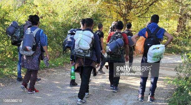 Group of Asian migrants are seen while marching on a dirt road, while attempting to illegaly cross into Croatia via Pljesevica mountain, near...