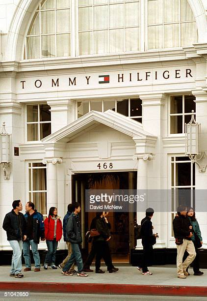 A Group Of Asian Tourists Meander By The Tommy Hilfiger Store On Rodeo Drive During A Shopping Trip To The Famous Beverly Hills California Shopping...