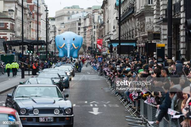 A group of Aston Martin cars followed by Ellie the Elephant Baloon during London's New Year's Day Parade 2018 Around 500000 spectators gather along...