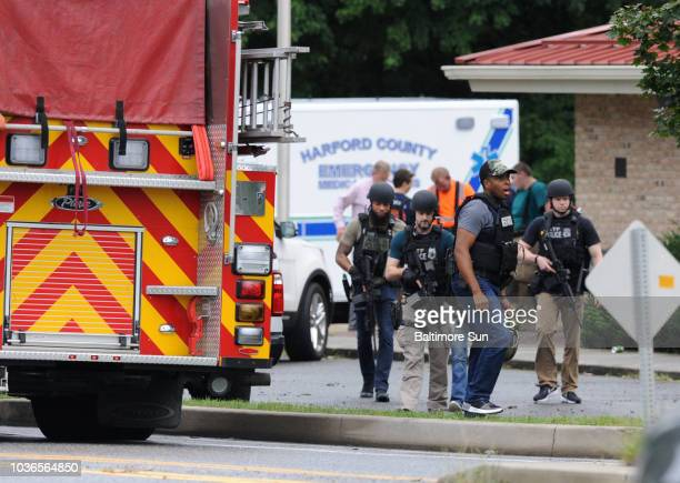 A group of ATF police make their way to the scene after staging at the Aberdeen Volunteer Fire Department substation near the shooting incident in...