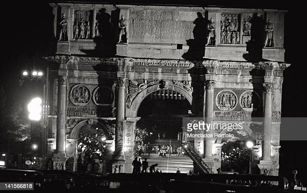 A group of athlete reaching the finishing line of the marathon under the Arch of Constantine Rome 10th September 1960