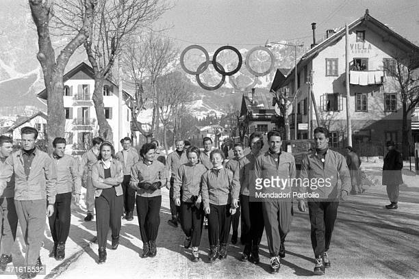 A group of athletes competing in the VII Olympic Winter Games walking in the streets of Cortina d'Ampezzo Cortina d'Ampezzo 1956