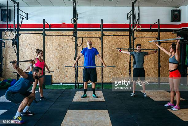 group of athletes exercising in gym - barre class stock photos and pictures