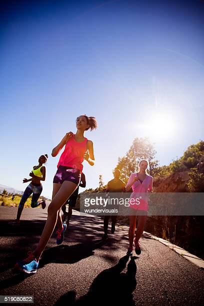 Group of athletes jogging outdoors