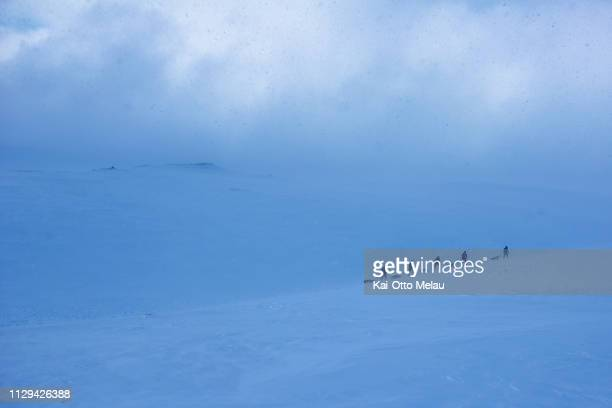 A group of athletes skiing into an approaching storm at Expedition Amundsen on March 7 2019 in Eidfjord Norway Expedition Amundsen is known as the...
