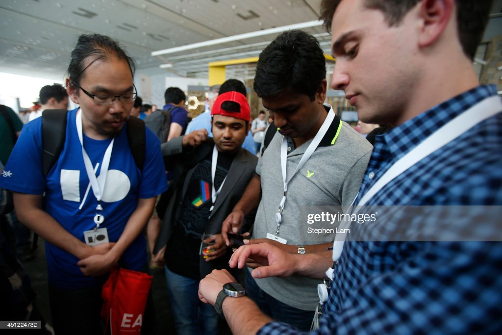 A group of attendees watch a product demonstration of a Motorola Moto 360 watch during the Google I/O Developers Conference at Moscone Center on June 25, 2014 in San Francisco, California. The seventh annual Google I/O Developers conference is expected to draw thousands through June 26.