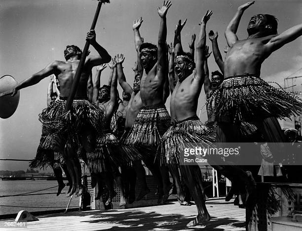 A group of Australian and New Zealand Maoris dancing the 'Haka' on their arrival in Portsmouth for coronation celebrations