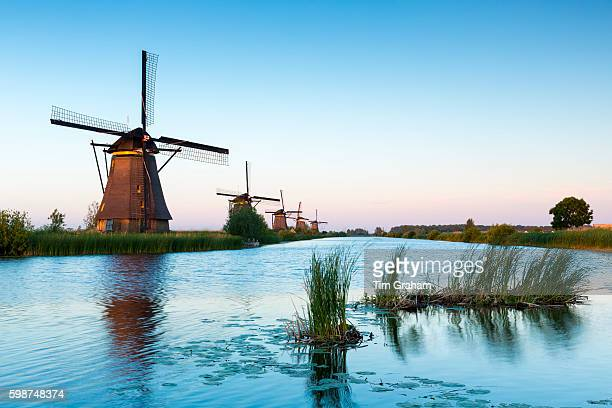Group of authentic windmills at Kinderdijk UNESCO World Heritage Site polder and dyke The Netherlands
