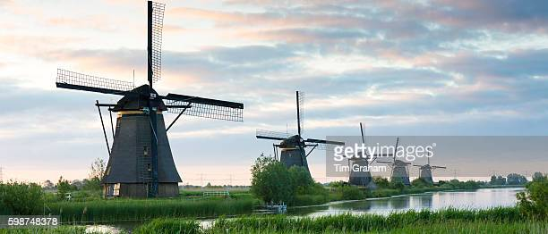 Group of authentic windmills early morning at Kinderdijk UNESCO World Heritage Site polder dyke The Netherlands