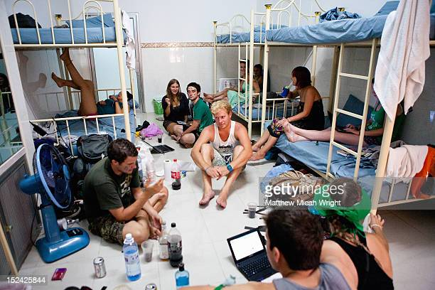 A group of backpackers a dorm room.